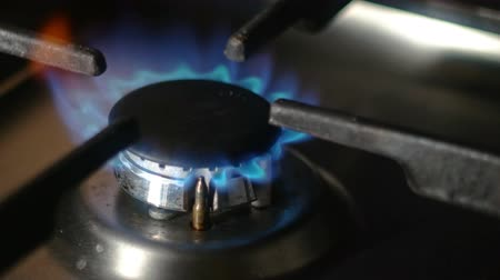 gas hob : Turning on the cooktop gas cooker. Kitchen burner turning on 4k footage.