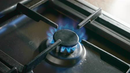 gazprom : Burning gas stove burner with blue fire from above