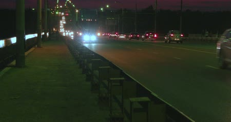 acil : night traffic on overpass and two children on small bicycles nighttime footage Stok Video