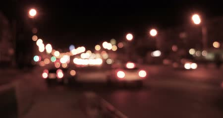 defocus : Blurred night traffic warm color toned Stock Footage