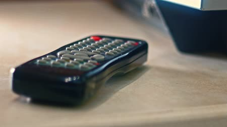 kapcsoló : Male hand take TV remote control off the table 4k footage