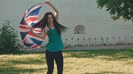 umutlu : Young girl turning with Union Jack in her hands in slow motion