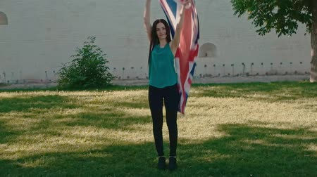 umutlu : Young girl playing with Union Jack in her hands in slow motion