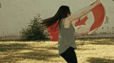 umutlu : Girl dancing with Canada nation flag in slow-motion