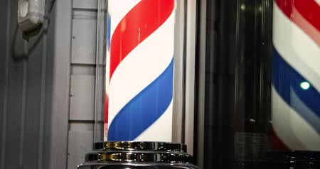 şifoniyer : Barber lamp working in the window of barbershop close-up. Stok Video