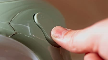 kitchenware : Pushing ON button close-up