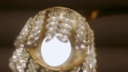 decorating : Upward look at cut-glass chandelier with moving crystals