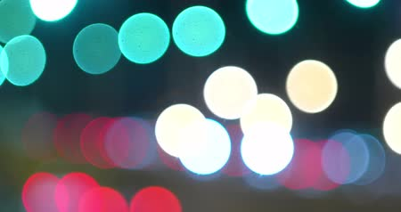 dividindo : Defocused night traffic lights of cars head- and backlights. Abstract blur background with moving blurred colorful spots. Stock Footage