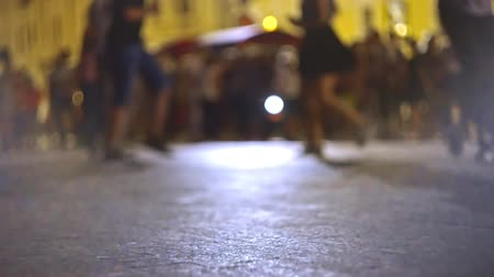 iğfal : Defocused couples on background dancing salsa in the street of Astrakhan Russia