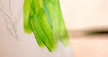 parşömen : Painting on canvas with green paint. Macro footage of acrillic art painting. Shallow focus.