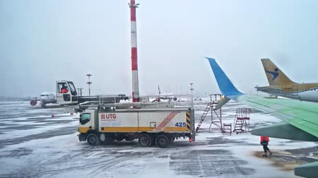 Saint-Petersburg Russia, 03 March 2019: De-ice track of UTG services after de-icing processing ready to go position. Preparing airliner for winter flight in Pulkovo Airport, St Petersburg