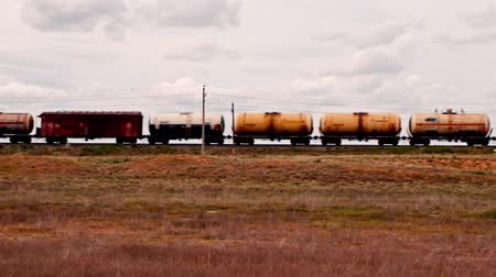 Astrakhan Russia 16 Apr. 2015: Train with many crude oil tanks and SFAT gazoline tanks in the country around Astrakhan. There ara oil and natural gas mining companies in the Astrakhan oblast