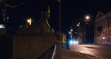 lehet : Saint-Petersburg Russia, 03 March 2019: Traffic in the Egypetsky bridge area. With Sphin statue on the left Stock mozgókép