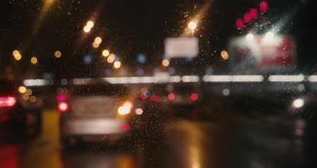 stoplight : Blurred video of cars moving slow toward Mexico borderline in rainy night Stock Footage