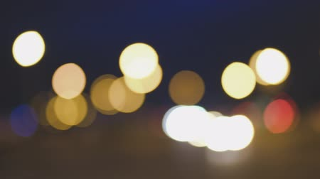 Urban Blur background. Moving bokeh circles of City night traffic vintage color. Defocused night traffic lights
