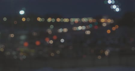 Defocused shoot of night city with many car-lights flow alonf freeway, urban night panorama 影像素材