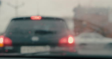 wiper : Car standing in traffic jam in front of traffic with windshield wipers working blurry shoot