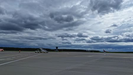 Moskow Russia, 22 Aug 2019: Vnukovo airfield with airplanes and shuttle buses and dramatic clouds above 影像素材