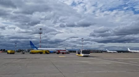 Moskow Russia, 22 Aug 2019: Vnukovo airfield with Pobeda airplane and grownd crew tracks and shuttle