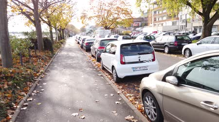 Bonn Germany, 06 November 2019: both sidewalks of Rhine embankment overcrouded with parked cars 4k 50fps clip