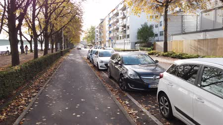 Bonn Germany, 06 November 2019: many cars parked on both sides of sidewalk of Rhine embankment 4k 50fps clip