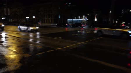 Bonn Germany, 06 November 2019: Night traffic near the UN building in rainy day 4k 50fps clip Dostupné videozáznamy