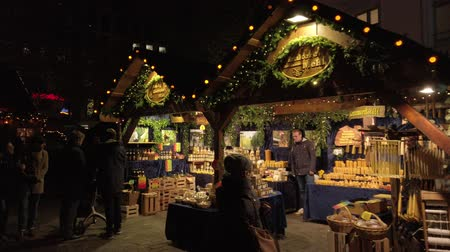 Bonn Germany, November 23 2019: Christmas fair with counter illuminated 4k 50fps 影像素材