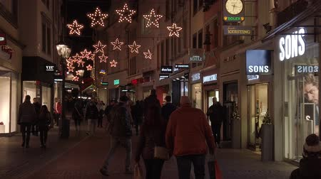 adil : Bonn Germany, November 23 2019: People walking in the decorated Christmas fair street 4k 50 fps clip Stok Video