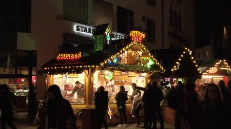 Bonn Germany, November 23 2019: Christmas fair, crowd of people walking in the street market 4k 50fps