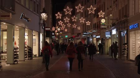 Bonn Germany, November 23 2019: Christmas fair, people walking along the decorated street pre-christmas time