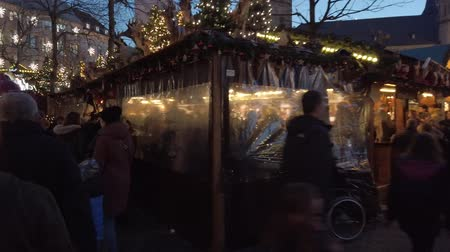 kardan adam : Bonn Germany, 30 November 2019: Christmas Market in the center of Bonn City. People walking in the street one of the most representative historical centers of Germanys cityes hyperlapse clip Stok Video