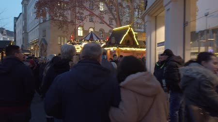 снежинки : Bonn Germany, 30 November 2019: Hyperlapse clip street in the center of Bonn City when Christmas market is taking place clip Стоковые видеозаписи