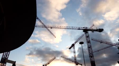 Bonn Germany, circa Dec. 2019: Construction cranes working at sunset, time lapse. 影像素材