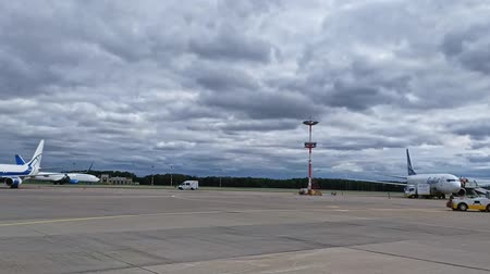 Moskow Russia, 22 Aug 2019: Vnukovo airfield with airplanes and shuttle buses