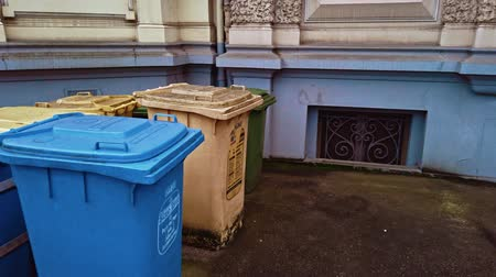 separado : Bonn Germany, 16 Dec 2019: Garbage dumpsters installed on the street for separate garbage collection