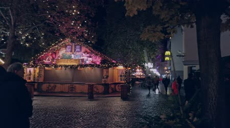 Bonn, Germany - 14 of Dec., 2019: Christmas market in the nighttime.Christmas market stopped working in the dead of night panning shot