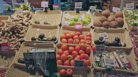 navegar : Bonn, Germany - 14 of Dec., 2019: interior shot of REWE supermarket in Bonn POV view. Look at fruits on shelves in mall Stock Footage