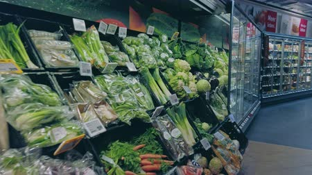 Bonn, Germany - 14 of Dec., 2019: interior shot of REWE supermarket in Bonn POV view. Healthy eating vegetables on the shelves of the Rewe mall