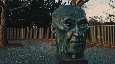 ingressou : Bonn Germany, 14 Dec 2019: Statue of Konrad Hermann Joseph Adenauer who served as the first Chancellor of the Federal Republic of Germany (West Germany) from 1949 to 1963 dolly out footage