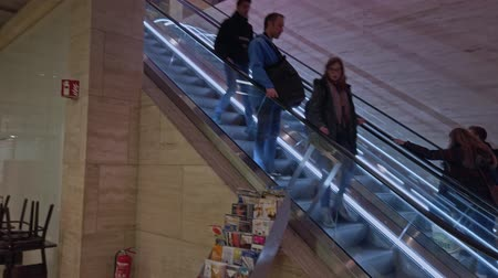 hurry up : Bonn, Germany - 14 of Dec., 2019: Pan shot ща еру escalators in the mall and lounge