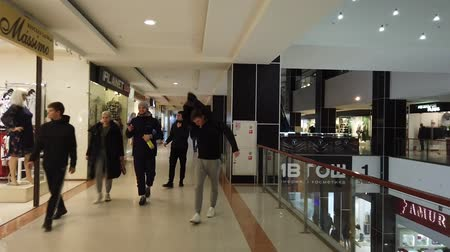 tüketici : Astrakhan, Russia, 20 Feb. 2020: A first-person walk through the multi-storey shopping centre POV FHD clip