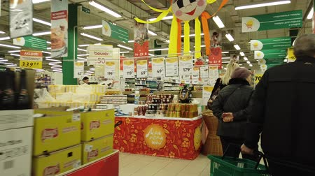 satın almak : Astrakhan, Russia, Feb 20, 2020: POV hyperlapse entry to supermarket where many discounts on goods