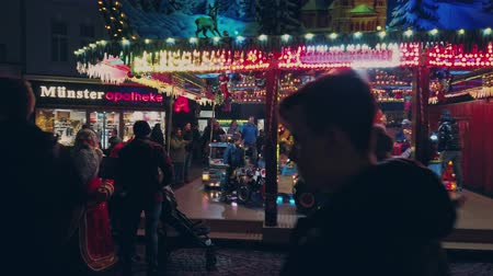 Bonn Germany, 23 Dec 2019: Carousel for public entertainment set at Christmas fair 4k slomo