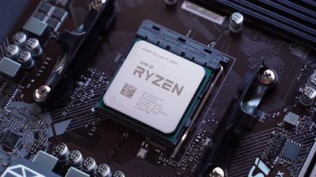 mikroişlemci : Valencia, Spain - December 07, 2019: AMD Ryzen 3600 processor in the B450 motherboard socket. New Zen 2, 7 nanometer desktop CPU by AMD. Very popular 3rd generation Ryzen 3000 CPU. Stok Video
