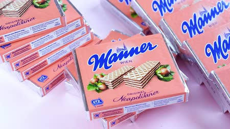 gofre : Valencia, Spain - December 07, 2019:Manner waffles. Neapolitan wafers, introduced in 1898. They are sold in blocks of ten hazelnut-cream filled wafers. Confectionery from the Austrian conglomerate