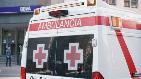 paramedic : Valencia,Spain - March 18, 2019:  Ambulance van. Red cross ambulance  car. Responding  to emergency. Stock Footage