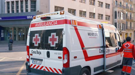 paramedics : Valencia,Spain - March 18, 2019:  Ambulance van. Red cross ambulance  car and paramedic. Responding  to emergency.