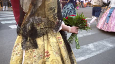 virgem : Fallas celebration, woman and girls dresses traditionally, procession. Celebration held in commemoration of Saint Joseph. Falleras in beautiful medieval dresses.