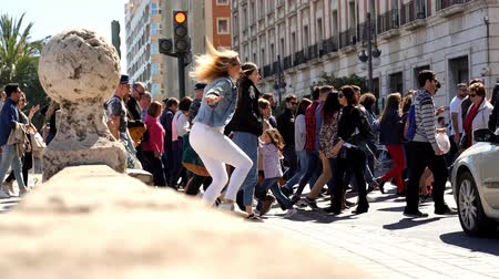 europe population : Large crowd of people crossing the street. Many people crossing. Valencia city center. Stock Footage