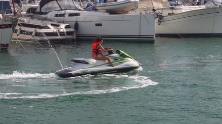 lancha : Cool Girl driving speed boat through Valencia port channel. Wild travel adventure, and power woman.